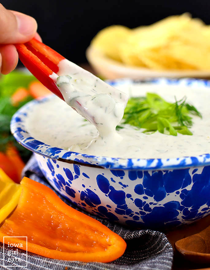 baby bell pepper dipping into a bowl of whipped feta without cream cheese