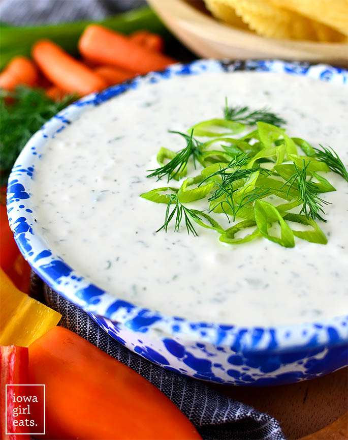whipped feta dip in a bowl topped with green onions and dill