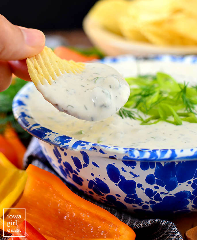 potato chip dunked into a bowl of whipped feta dip