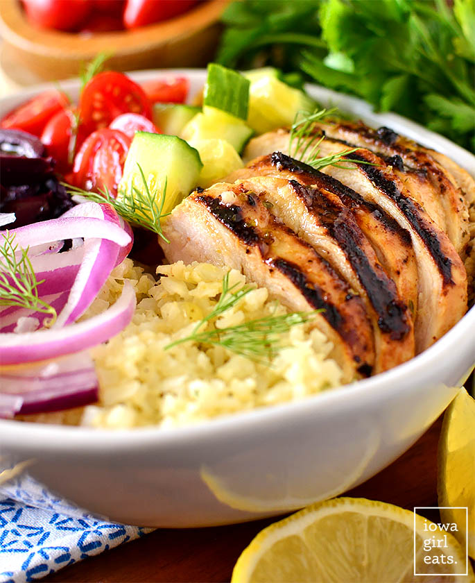 low carb greek chicken bowl with cauliflower rice and grilled chicken