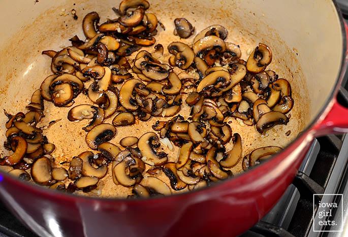garlic butter mushrooms sauteing in a soup pot