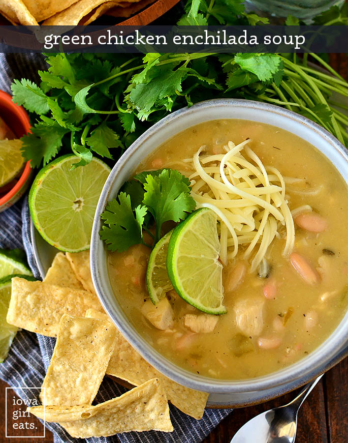 Overhead photo of bowl of green chicken enchilada soup with toppings