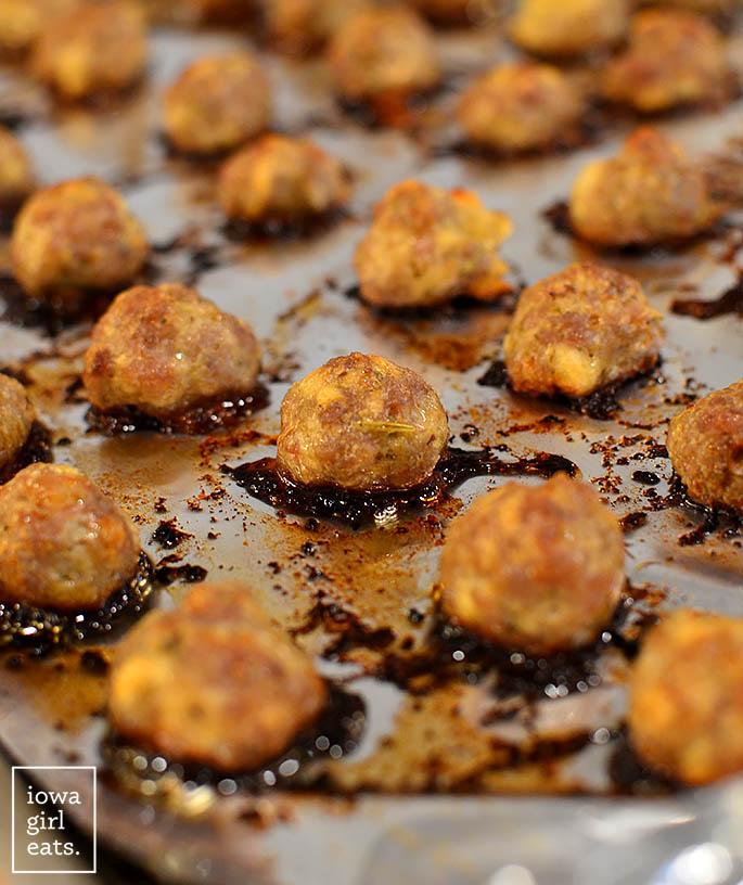 baked pork meatballs on a baking sheet